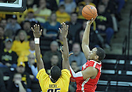 January 07, 2011: Ohio State Buckeyes forward Jared Sullinger (0) puts up a shot over Iowa Hawkeyes forward Devon Archie (35) during the the NCAA basketball game between the Ohio State Buckeyes and the Iowa Hawkeyes at Carver-Hawkeye Arena in Iowa City, Iowa on Saturday, January 7, 2012.