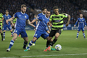 Huddersfield Town striker Nahki Wells (21) is pushed out of the Sheffield Wednesday penalty box by the attention of Sam Hutchinson (Sheffield Wednesday) and Jack Hunt (Sheffield Wednesday) during the EFL Sky Bet Championship play off second leg match between Sheffield Wednesday and Huddersfield Town at Hillsborough, Sheffield, England on 17 May 2017. Photo by Mark P Doherty.