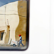 An ice cream vendor and his cart are reflected in a bus's rear window in Agua Perieta, Mexico. ltqmb DULCES