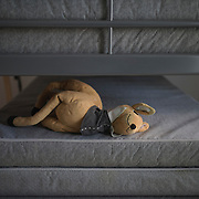 An abandoned deer soft toy lying on top of a stack of mattresses in Villa Artemis, a shelter for 30 refugee women and their children in the grounds of Leros Hospital. <br />