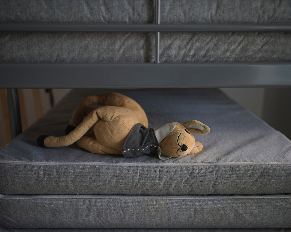 An abandoned deer soft toy lying on top of a stack of mattresses in Villa Artemis, a shelter for 30 refugee women and their children in the grounds of Leros Hospital. <br /> <br /> Opened in September 2015, the shelter was run by the Leros Solidarity Network. However, Villa Artemis was closed down shortly after the opening of a 'Hotspot' (EU-run migrant's reception centres) camp in Lepida in February 2016.