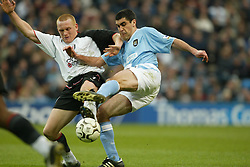 MANCHESTER, ENGLAND - Saturday, March 27, 2004: Manchester City's Claudio Reyna and Fulham's Mark Pembridge during the Premiership match at the City of Manchester Stadium. (Pic by David Rawcliffe/Propaganda)
