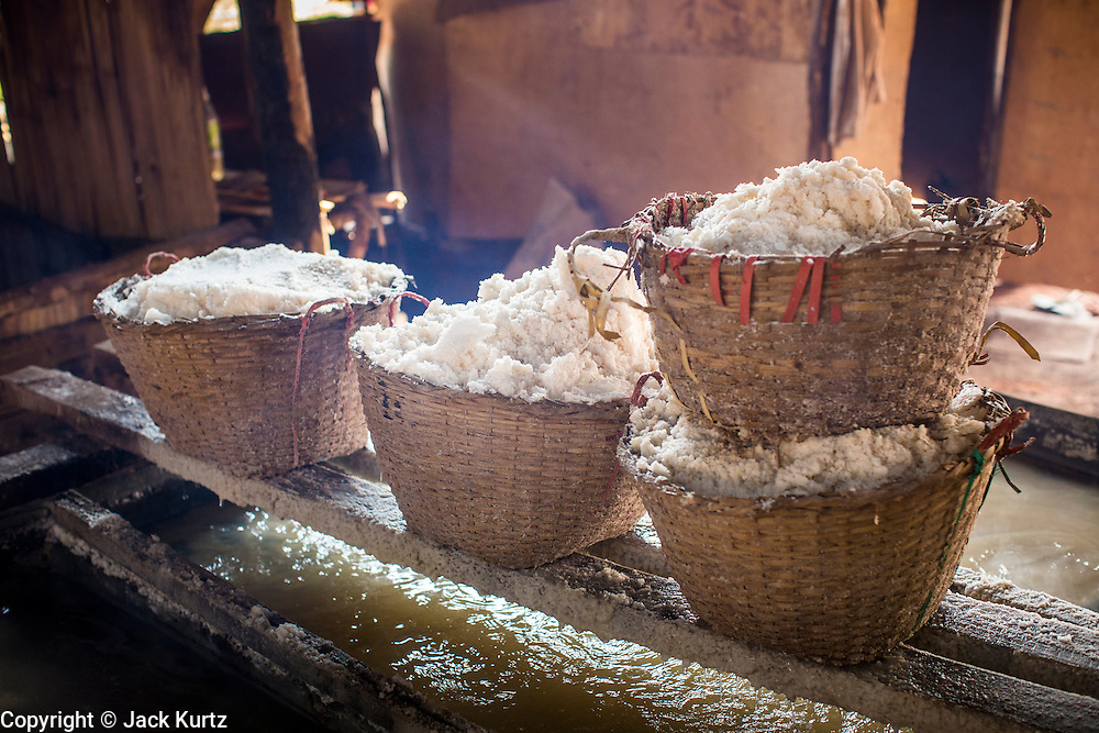 13 MARCH 2013 - BOTEN, LUANG NAMTHA, LAOS:  Baskets of salt in a salt factory in Boten, Laos. Salt in Boten is made by boiling briny water and collecting the salt that is left behind. The salt wells in Boten, Laos, just south of the Chinese border, have brought a measure of fame to the area for centuries. French forces asserted French dominance over the region in 1894 to control the salt trade. Some of the salt works face an uncertain future because of economic development from China. The area is being developed into a huge parking lot to accommodate truck and tourist traffic into and out of China. PHOTO BY JACK KURTZ