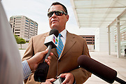 15 JULY 2010 - PHOENIX, AZ: Augustine Jimenez attorney for David Salgado, talks to reporters before going into the courthouse. People for and against SB 1070 picketed the front of the Sandra Day O'Connor US Courthouse (CQ) in Phoenix Thursday morning during the first hearing against SB 1070.    PHOTO BY JACK KURTZ