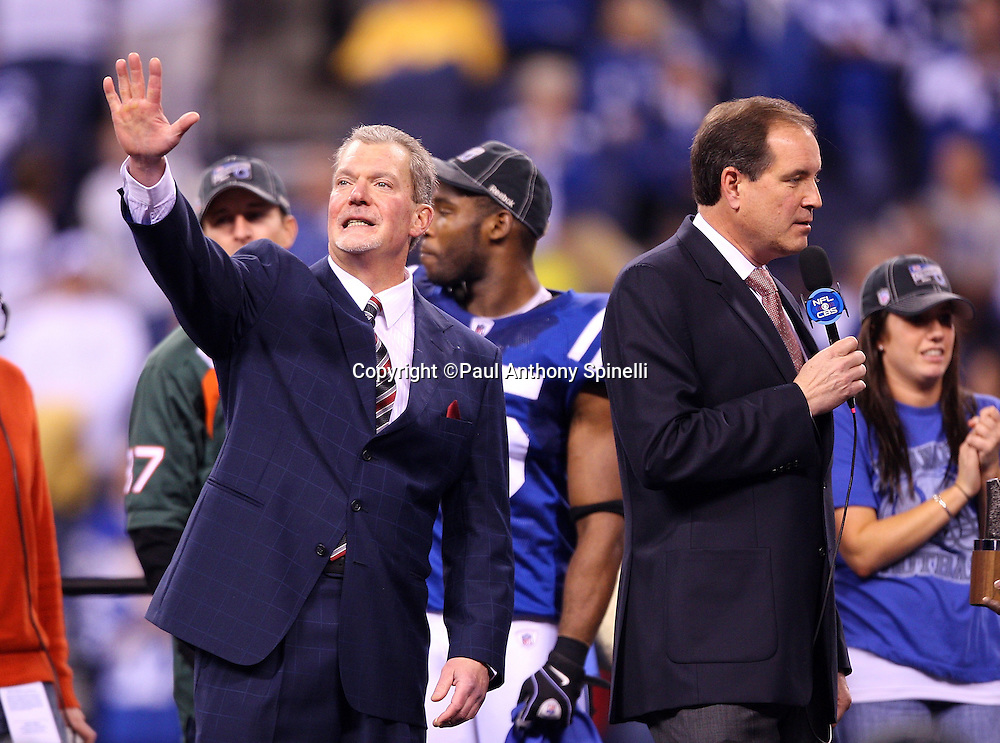 Indianapolis Colts Owner and Chief Executive Officer Jim Irsay waves while CBS announcer Jim Nantz hosts the postgame trophy presentation after the AFC Championship football game against the New York Jets, January 24, 2010 in Indianapolis, Indiana. The Colts won the game 30-17. ©Paul Anthony Spinelli
