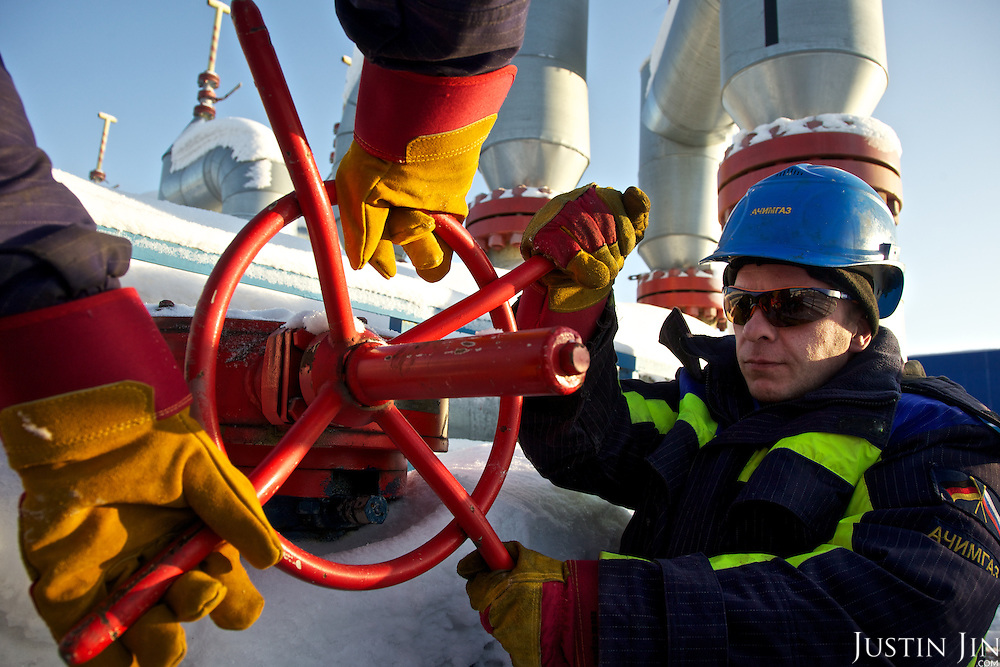 Workers opens at pipe at the gas facility at Achimgaz in Novy Urengoi, Siberia, Russia.