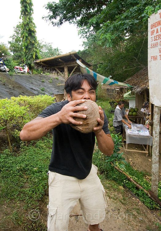 The Coconut King. A man in Bohol, Philippines, de-shelling a coconut with his bare teeth.