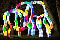 © Licensed to London News Pictures. 18/01/2017. London, UK. A man walks through a multicoloured  lantern on display at he Chiswick House Magic Lantern Festival. The Festival is a fusion of art, heritage and culture. Illuminating outdoor installations of beautifully sculpted lanterns taking various forms. Opening tomorrow and running until February 26th 2017 the theme for this year's festival is: 'Explore The Silk Road'. Visitors will discover life-sized and oversized lantern scenes, which represent and highlight this significant route of trade and culture from Europe to Ancient China.Photo credit: Peter Macdiarmid/LNP