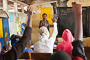 Georgina teaches literacy young men training to become mechanics as part of the Into Work programme run by Action for children in conflict (AFCIC) in Thika, Kenya.  They go to school between 7 and 9 am to learn literacy and maths, followed by going to various garages to learn the practical skills.