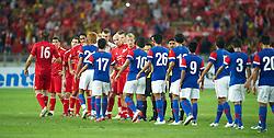 KUALA LUMPUR, MALAYSIA - Saturday, July 16, 2011: Liverpool players shake hands with Malaysia players at the National Stadium Bukit Jalil in Kuala Lumpur on day six of the club's Asia Tour. (Photo by David Rawcliffe/Propaganda)