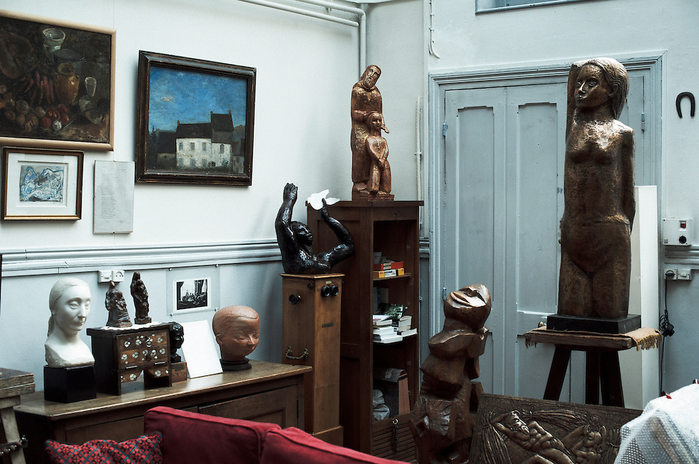 PARIS, FRANCE. SEPTEMBER 20, 2011. Tereska Torres' living room, filled with her father's sculptures. Photo: Antoine Doyen.