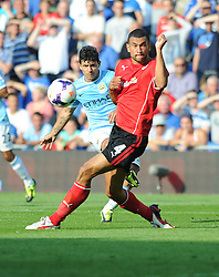 Manchester City's Sergio Aguero shoots indside the box in the extra time but fails to score.  - Photo mandatory by-line: Alex James/JMP - Tel: Mobile: 07966 386802 25/08/2013 - SPORT - FOOTBALL - Cardiff City Stadium - Cardiff -  Cardiff City V Manchester City - Barclays Premier League