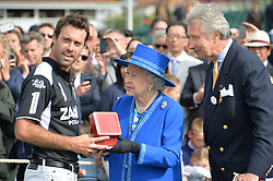 Left to right, Facundo Pieres, HM The Queen and Arnaud Bamberger at the Cartier Queen's Cup Final polo held at Guards Polo Club, Smith's Lawn, Windsor Great Park, Egham, Surrey on 15th June 2014.