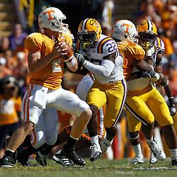 Oct 2, 2010; Baton Rouge, LA, USA; LSU Tigers linebacker Ryan Baker (22) pressures Tennessee Volunteers quarterback Matt Simms (2) during the first half at Tiger Stadium.  Mandatory Credit: Derick E. Hingle