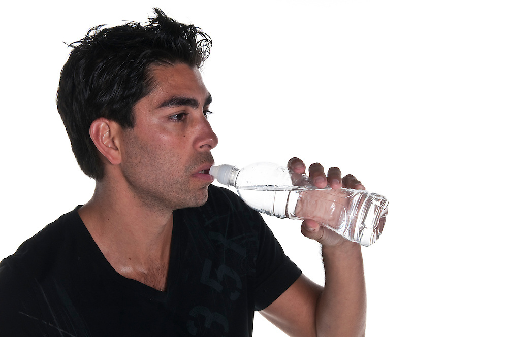 Young man drinking water thirsty from bottle.