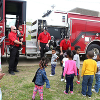 Lauren Wood | Buy at photos.djournal.com<br /> Sgt. Kevin Fulghan, Firefighters Jake Bennett and Joel Goss speak to children as they visit the Brown Bear Child Care and Learning Center Wednesday morning.