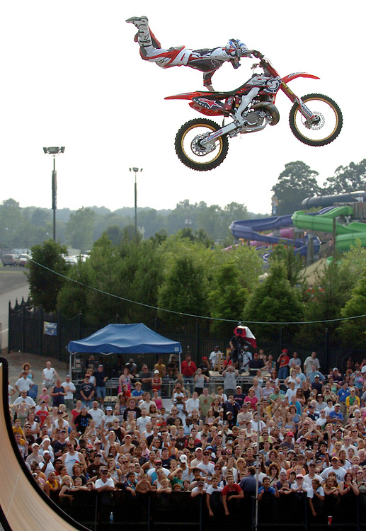 Biker Drake McElroy takes a jump in Tony Hawk's Boom Boom Huck Jam show at Six Flags New England in Agawam, Mass.