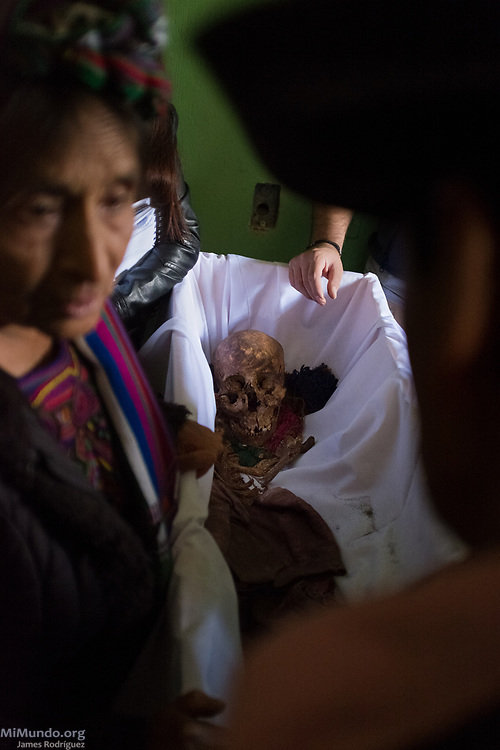 Ixil Mayan residents of Nebaj gather as the human remains of 36 war victims are returned to their surviving family members for a proper burial. Most of the victims, exhumed from mass graves in Xe'xuxcap, near Acul, starved in the mountainside while fleeing State-led repression in 1982. Most of the remains, exhumed by members of the Forensic Anthropology Foundation of Guatemala (FAFG) in 2013, were identified using DNA analysis and buried 35 years after their death. Nebaj, Quiché, Guatemala. February 2, 2017.
