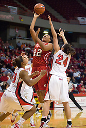 20 November 2010: Allyssa Decker gets off a shot while surrounded by Shala Jackson and Emily Hanley during an NCAA Womens basketball game between the Southern Illinois-Edwardsville Cougars and the Illinois State Redbirds at Redbird Arena in Normal Illinois.