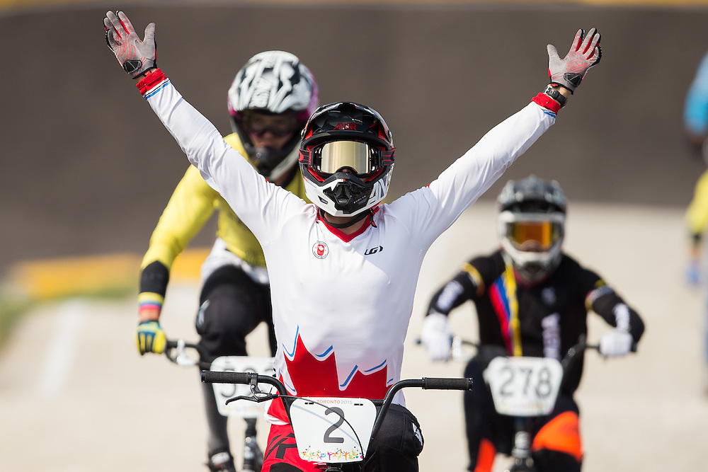Canada's  Tory Nyhaug celebrates as he crosses the finish line to with the gold medal in the BMX at the 2015 Pan American Games in Toronto, Canada July 11,  2015.  AFP PHOTO/GEOFF ROBINS