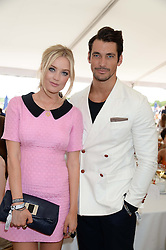 DAVID GANDY and LAURA WHITMORE at the Boujis hospitality at the Audi International Polo at Guards Polo Windsor Great Park, Egham, Surrey on 28th July 2013.