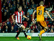 James Tarkowski of Brentford and Michael Dawson of Hull City during the Sky Bet Championship match between Brentford and Hull City at Griffin Park, London<br /> Picture by Mark D Fuller/Focus Images Ltd +44 7774 216216<br /> 03/11/2015