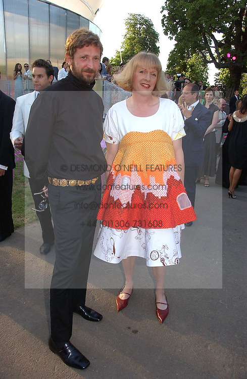 Left to right, STEFANO PILATI and GRAYSON PERRY at the Serpentine Gallery Summer party sponsored by Yves Saint Laurent held at the Serpentine Gallery, Kensington Gardens, London W2 on 11th July 2006.<br />