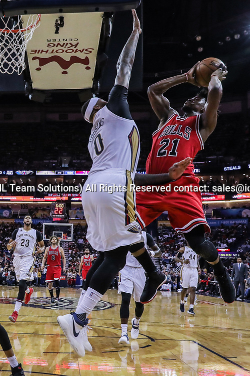 NEW ORLEANS, LA - APRIL 02: Chicago Bulls forward Jimmy Butler (21) shoots a jump shot against New Orleans Pelicans forward DeMarcus Cousins (0) during the game between the New Orleans Pelicans and the against the Chicago Bulls on April 2, 2017, at Smoothie King Center in New Orleans, LA.  Bull won 117-110. (Photo by Stephen Lew/Icon Sportswire)