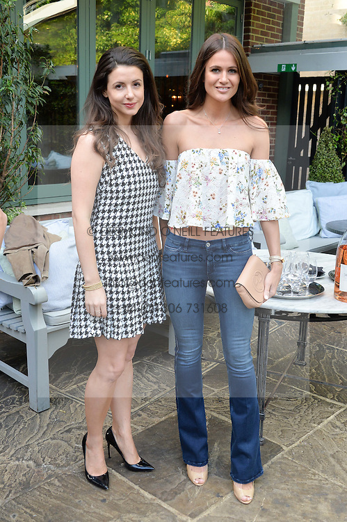Left to right, SHIRLEY LEIGH WOOD-OAKES and KIM JOHNSON at a party to celebrate 'A Year In The Garden' celebrating the first year of The Ivy Chelsea Garden, 197 King's Road, London on 16th May 2016.