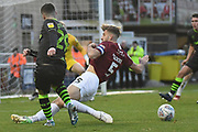 Forest Green Rovers forward (on loan from Celtic) Jack Aitchison (29)  gets a cross away under pressure from Northampton Town defender Charlie Goode (5) during the EFL Sky Bet League 2 match between Northampton Town and Forest Green Rovers at the PTS Academy Stadium, Northampton, England on 14 December 2019.
