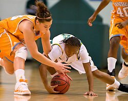 December 22, 2009; San Francisco, CA, USA;  Tennessee Lady Volunteers guard Taber Spani (13) battles with San Francisco Dons guard Brittany Brumfield (4) for a loose ball during the first half at War Memorial Gym.  Tennessee defeated San Francisco 89-34.