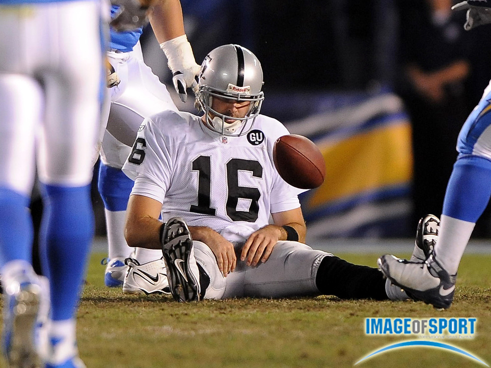 Dec 4, 2008; San Diego, CA, USA; Oakland Raiders quarterback Andrew Walter (16) reacts after being sacked in the fourth quarter against the San Diego Chargers at Qualcomm Stadium. The Chargers defeated the Raiders 34-7.