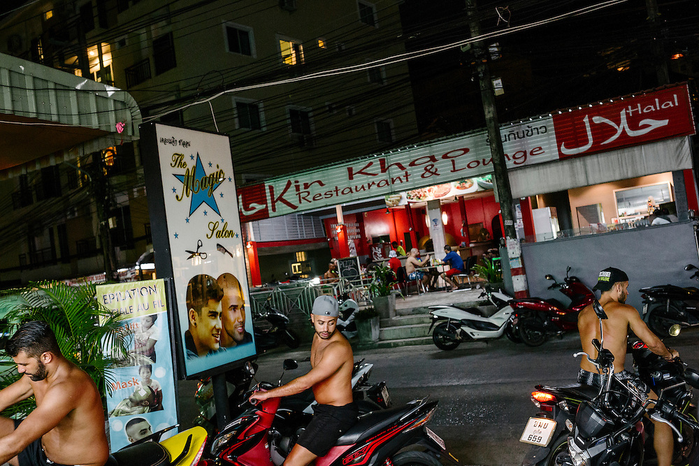 French tourists from the Parisien suburbs wait their turn to get a hair cut and a shave in this Thai hairdresser on Nan Nai Road. This road is frequented often by these tourists because of the halal restaraunts  that often serve French food nearby. In many ways some parts of the street is like a minature French enclave of the suburbs.