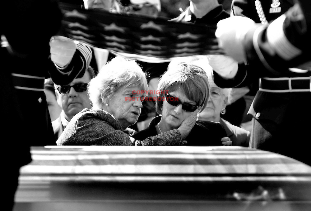 """Final Goodbye"".Jackie Raymond, mother of soldier Jared Raymond who was killed in Iraq, is hugged by her mother Agnes Raymond at his Massachusetts' funeral.."