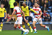 Oxford United striker Rob Hall (7) takes on Doncaster Rovers defender Reece James (3)and Doncaster Rovers forward Jon Taylor (10) during the EFL Sky Bet League 1 match between Oxford United and Doncaster Rovers at the Kassam Stadium, Oxford, England on 12 October 2019.