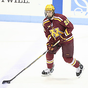 Christian Isackson #26 of the Minnesota Gophers warms up on the ice prior to the game against the Northeastern Huskies at Matthews Arena on November 29, 2014 in Boston, Massachusetts. (Photo by Elan Kawesch)