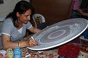 ceramic artist painting large plate; intricate design; ceramic factory; Cappadocia; Avanos; Turkey
