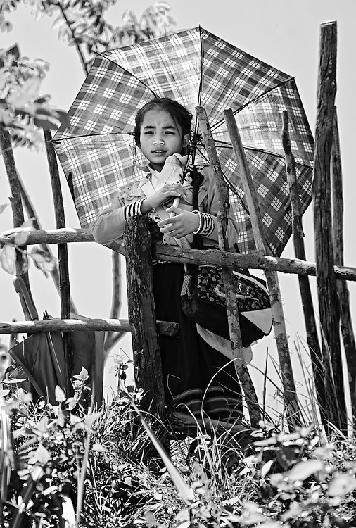 A girl on her way to school near Luang Prabang, Laos.