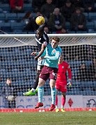 1st April 2018, Dens Park, Dundee, Scotland; Scottish Premier League football, Dundee versus Heart of Midlothian; Genseric Kusunga of Dundee out jumps Euan Henderson of Hearts