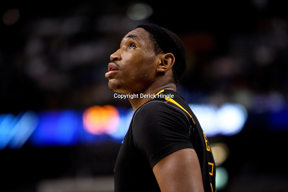 Mar 19, 2011; Tampa, FL, USA; West Virginia Mountaineers forward Kevin Jones (5) reacts in the final moments during the second half of the third round of the 2011 NCAA men's basketball tournament against the Kentucky Wildcats at the St. Pete Times Forum. Kentucky defeated West Virginia 71-63.  Mandatory Credit: Derick E. Hingle