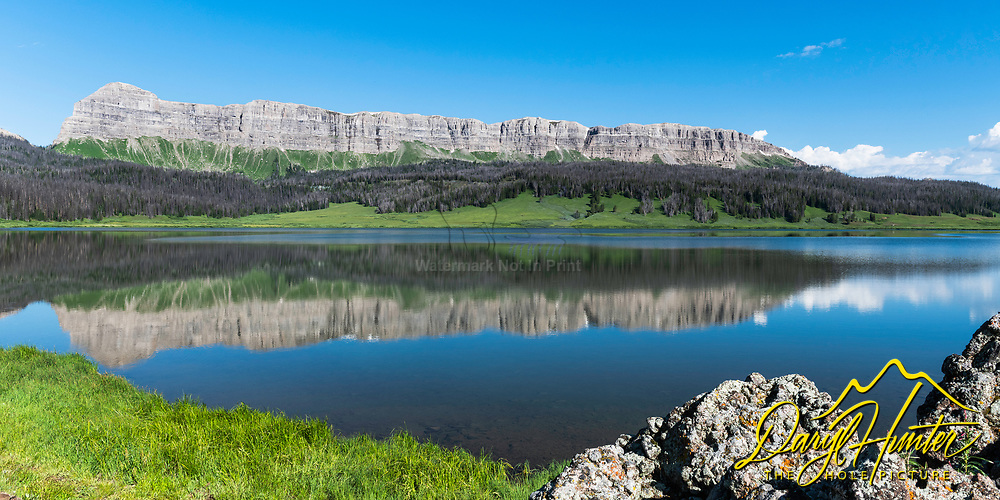The Breccia Cliffs reflection upon the still waters of Brooks Lake high in the Absaroka Mountains of Wyoming.