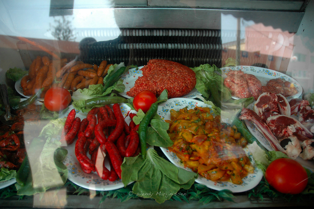 Meat being displayed in a local restaurant in Berkane. Berkane is a city in northeastern Morocco in the area of Thrifa. Morocco, 2006
