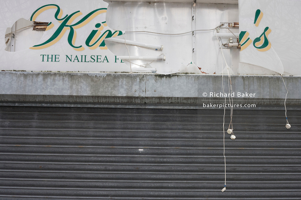 Shattered shop sign and light fittings in a shopping precinct, a victim of the UK recession. .