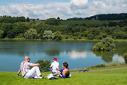 Family having picnic beside Linlithgow Loch at  Linlithgow Palace in Scotland, United Kingdom