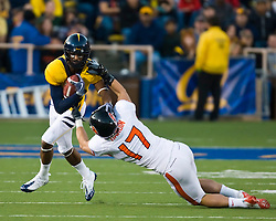 November 7, 2009; Berkeley, CA, USA;  California Golden Bears wide receiver Verran Tucker (86) breaks a tackle by Oregon State Beavers cornerback Brandon Hardin (17) during the second quarter at Memorial Stadium.