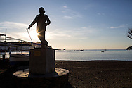 A statue of Salvador Dali on the harbor in Cadaques.Dali had a home in Cadaques for a number of years. Cadaques, Spain