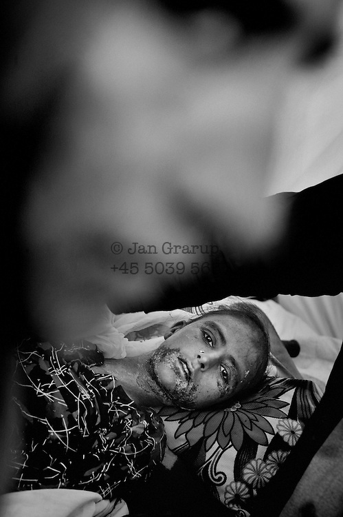 Young woman in the PIMA camp.<br />  She had been given the wrong medicine by Pakistani military doctors immediately after the earthquake. Now she was <br /> dying.  Nov. 2005