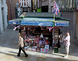 22 April 2011. London, England..Tourist trinkets to celebrate the Royal wedding and london in general at a stall on Oxford Street in the heart of London's West End. Mugs, plates, key rings, fridge magnets, imitation engagement rings, flags and more..Photo; Charlie Varley.