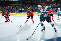 KELOWNA, CANADA - APRIL 8: Cody Glass #8 of the Portland Winterhawks checks Rodney Southam #17 of the Kelowna Rockets as he skates with the puck during first period on April 8, 2017 at Prospera Place in Kelowna, British Columbia, Canada.  (Photo by Marissa Baecker/Shoot the Breeze)  *** Local Caption ***