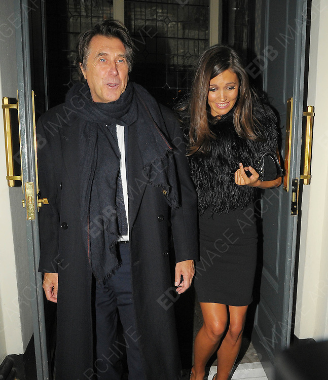 19.OCTOBER.2010. LONDON<br /> <br /> BRYAN FERRY AND GIRLFRIEND AMANDA SHEPPARD LEAVING HIS ALBUM LAUNCH DINNER PARTY HELD AT DEAN STREET TOWN HOUSE AND DINING ROOMS IN SOHO.<br /> <br /> BYLINE: EDBIMAGEARCHIVE.COM<br /> <br /> *THIS IMAGE IS STRICTLY FOR UK NEWSPAPERS AND MAGAZINES ONLY*<br /> *FOR WORLD WIDE SALES AND WEB USE PLEASE CONTACT EDBIMAGEARCHIVE - 0208 954 5968*